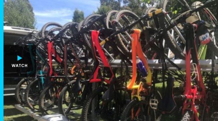 Landline tv show screen capture of mountain bikes on a rack