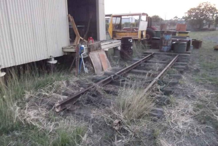 Behind the goods shed before cleanup, untidy